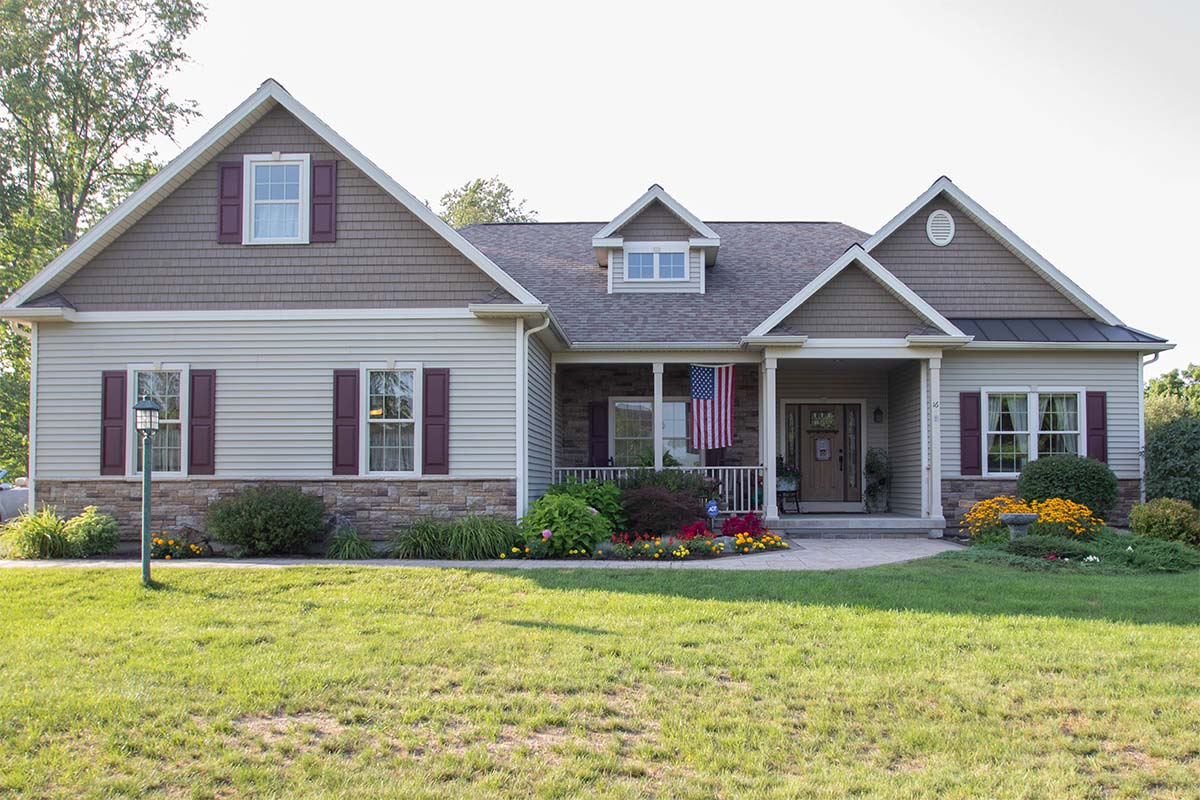 Custom Home with American Flag on Porch